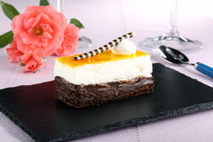 Dessert orange  cake  on black stone Stock Photos