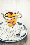 Dessert of orange slices and berries cranberries Stock Photos