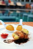 Dessert at outdoor. Dessert buffet outdoor on rattan table near by swimming pool Royalty Free Stock Photography