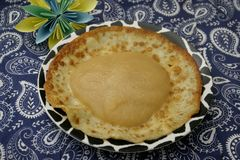 Dessert of pan cakes. A dessert of pan cakes with a puree of apples Royalty Free Stock Photos