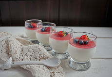 Dessert panna cotta in a glass and fresh berries Stock Images