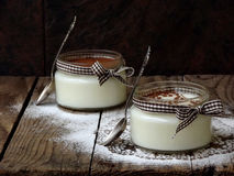 Dessert panna cotta. In jar on a wooden background stock photo