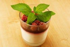 Dessert panna cotta. Panna cotta dessert with raspberries and mint Royalty Free Stock Photography