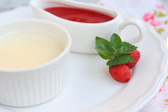 Dessert panna cotta with strawberry sauce Stock Photography