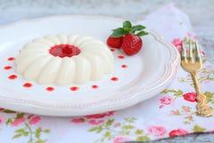 Dessert panna cotta with strawberry sauce Royalty Free Stock Photos
