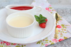 Dessert panna cotta with strawberry sauce Royalty Free Stock Images