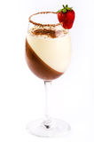 Dessert pannacotta in a glass on a white background. Dessert pannacotta with strawberries and chocolate in a glass on a white background Stock Photos
