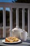 Dessert on a patio - fruitcake with tea. A plate with fruitcake and a cup of tea - outdoors breakfast Stock Photography