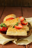 Dessert patties puff pastry with strawberries Stock Photo