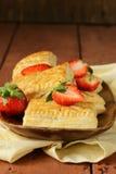 Dessert patties puff pastry with strawberries Stock Photo