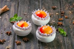 dessert pavlova with peach decor and meringue on a wooden stand royalty free stock photos