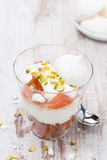 Dessert with peaches, whipped cream and meringue, top view Stock Images