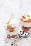 Dessert with peaches, whipped cream and meringue on white table Stock Image