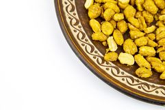Dessert - peanuts on a platter, on a white background stock photo