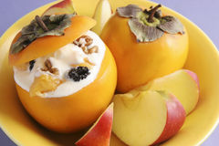 Dessert with persimmon. Stock Image