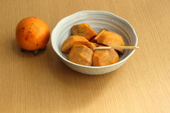 Dessert of persimmon peeled. Autumn fruit, dessert of persimmon Royalty Free Stock Photography