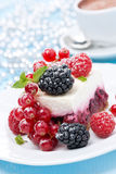 Dessert - a piece of cake with fresh berries and coffee Royalty Free Stock Image
