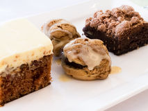 Dessert plate. Four dessert on a plate Royalty Free Stock Image