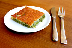 Dessert plate; kadayif. Turkish dessert kadayif made from pulp and pistachio Royalty Free Stock Images