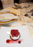 Dessert on plate in restaurant. With festive table arrangement in blurred  background Stock Photo