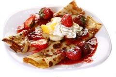 Dessert plate witn pancakes and banan. A dessert plate witn pancakes and banan stock image