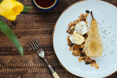 Dessert of Poached Pear, Poppy Seeds, Granola and Clotted Cream on Table Stock Images