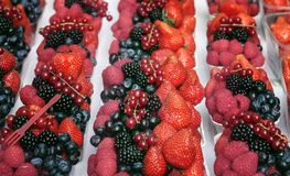 Dessert portion of ripe berries: raspberries, strawberries, blueberries. Dessert portion of ripe berries: raspberries, strawberries blueberries Stock Photos