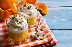 Dessert from the pumpkin. And seeds with whipped cream. Selective focus Royalty Free Stock Photos