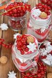 Dessert with red currant and whipped cream Stock Images