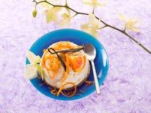 Dessert ricotta with orange Stock Photos