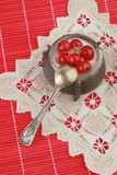 Dessert in Russian style. Red currant with sour cream on the white and red napkins Royalty Free Stock Photos