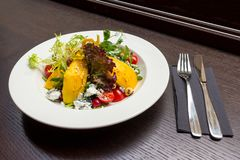 Salad with mango and goat cheese Stock Image