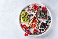 Dessert sandwiches with berries Royalty Free Stock Images