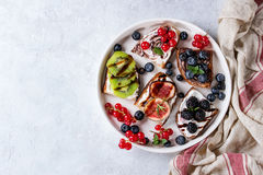 Dessert sandwiches with berries Royalty Free Stock Photography