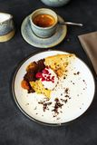 Dessert with semolina,cheese,cream,buckthorn,raspberry and coffee. Royalty Free Stock Photos