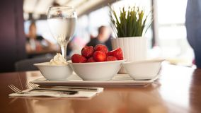 Dessert served in cafe, restaurant or bakery. White chocolate fo. Ndant with vanilla ice cream and strawberry ,Close up of delicious strawberries with cream and Stock Images