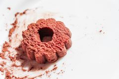 Dessert from short pastry. Chocolate biscuits with a sprinkle of ground cocoa beans, on a white plate. Dessert from short pastry Stock Photography
