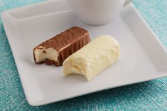 Dessert with soft cheese glazed with chocolate stock photography