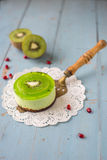 Dessert souffle with kiwi on a wooden background Royalty Free Stock Photos