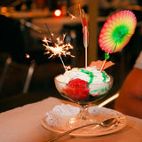 Dessert with sparkler Stock Photography