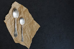 Dessert spoon and teaspoon Royalty Free Stock Image