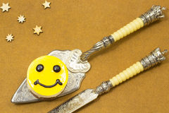 For dessert spoon yellow cake with brown eyes. Near the dessert. Knife. Stars royalty free stock image