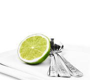 Dessert Spoons & Lime Royalty Free Stock Photos