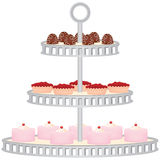 Dessert Stand. An elegant silver dessert or cake stand with small cakes, tarts and chocolates Royalty Free Stock Photo