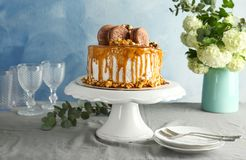 Dessert stand with delicious caramel cake. On table royalty free stock photography