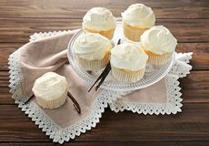 Dessert stand with tasty vanilla cupcakes Stock Photo