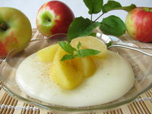 Dessert with stewed apples. Dessert with blancmange and stewed apples royalty free stock photography