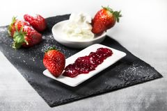 Dessert on a stone plate stock photography