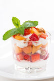 Dessert with strawberries, apricots, whipped cream and granola Royalty Free Stock Image