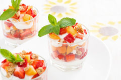 Dessert with strawberries, apricots, whipped cream and mint Stock Images